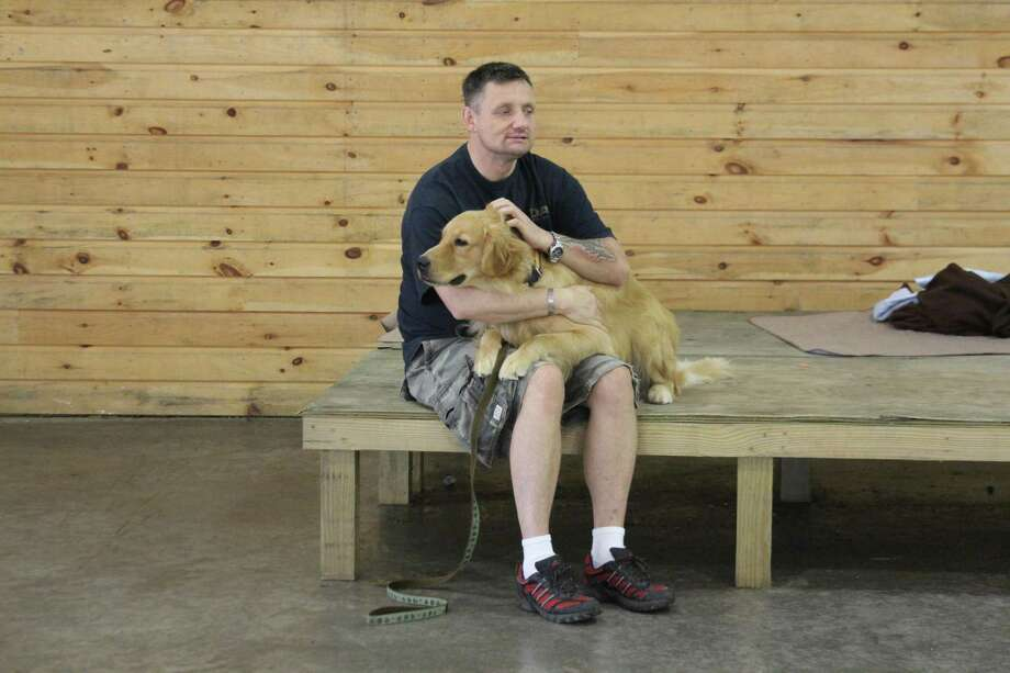 """ECAD Project HEAL Graduate, Veteran Greg Kolodziejczyk and his Service Dog Valor, enjoy a day on the beach in the upcoming documentary """"To Be of Service,"""" Photo: """"To Be Of Service"""" / Contributed Photo"""