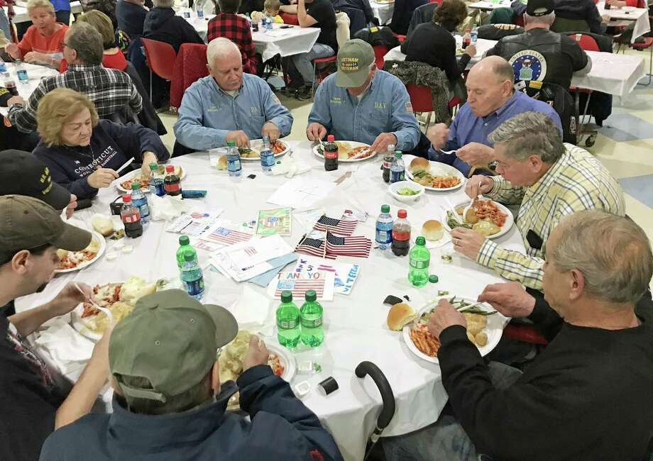 The eighth annual Veteran's Day dinner in Portland, which drew 250 people Sunday, was so well-attended, extra tables had to be brought in to accommodate everyone. Photo: Jeff Mill / Hearst Connecticut Media