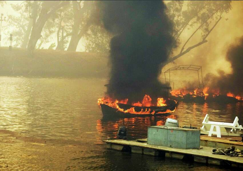 AFTER: Homes and boats on Malibou Lake burst into flames.