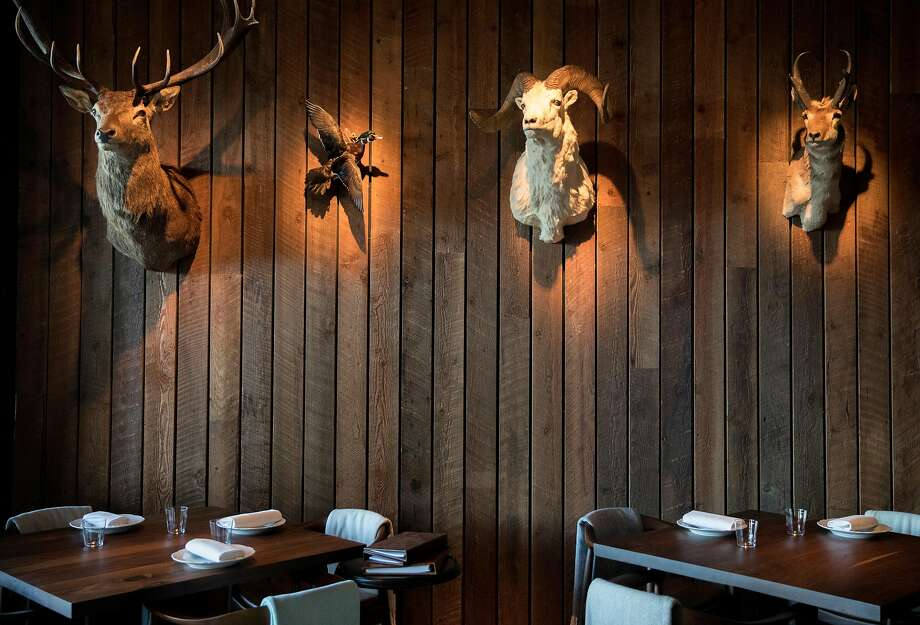 Animal heads and other trophies align the walls of the Game Room at Angler along the Embarcadero in San Francisco, Calif. Wednesday, Nov. 7, 2018. Photo: Jessica Christian, The Chronicle