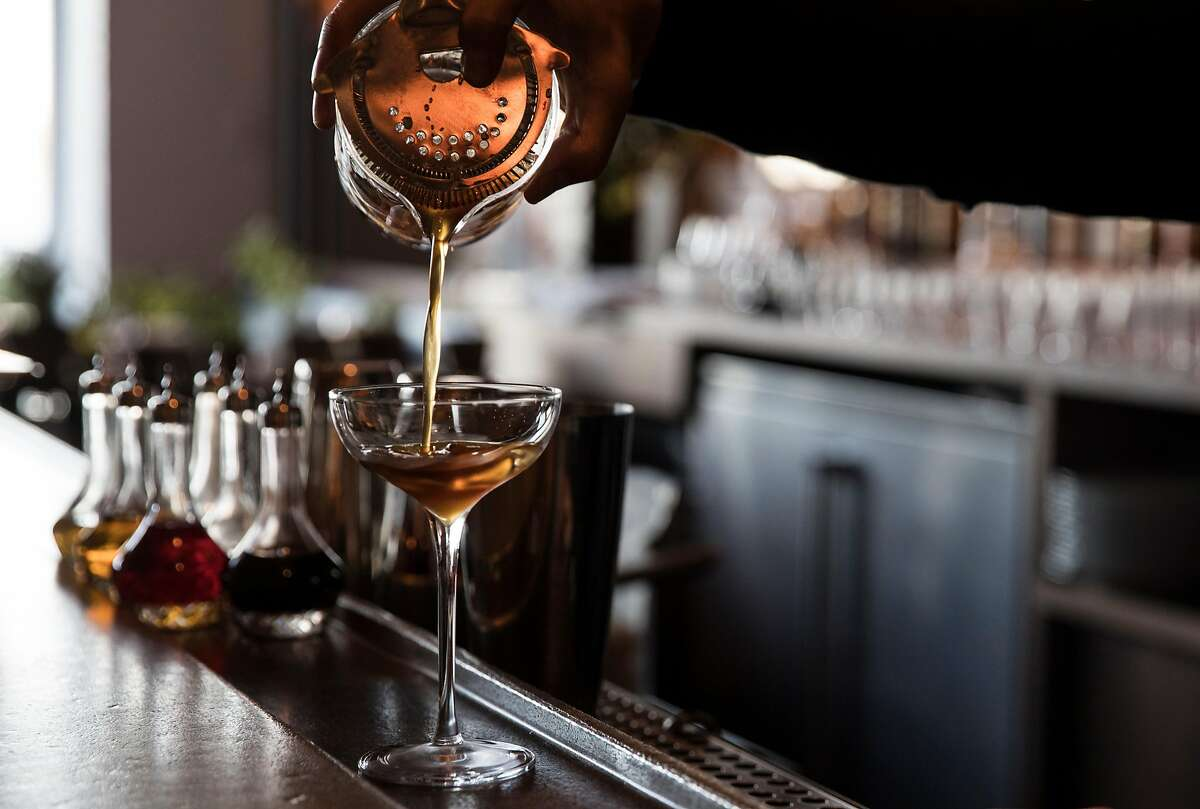 A bartender creates a White Russian behind the bar at Angler along the Embarcadero in San Francisco, Calif. Wednesday, Nov. 7, 2018.
