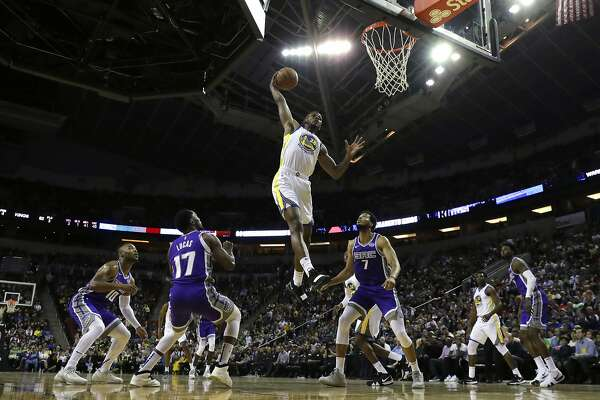 Golden State Warriors forward Alfonzo McKinnie dunks against the Sacramento Kings during the second half of an NBA basketball preseason game, Friday, Oct. 5, 2018, in Seattle. The Warriors won 122-94. (AP Photo/Ted S. Warren)