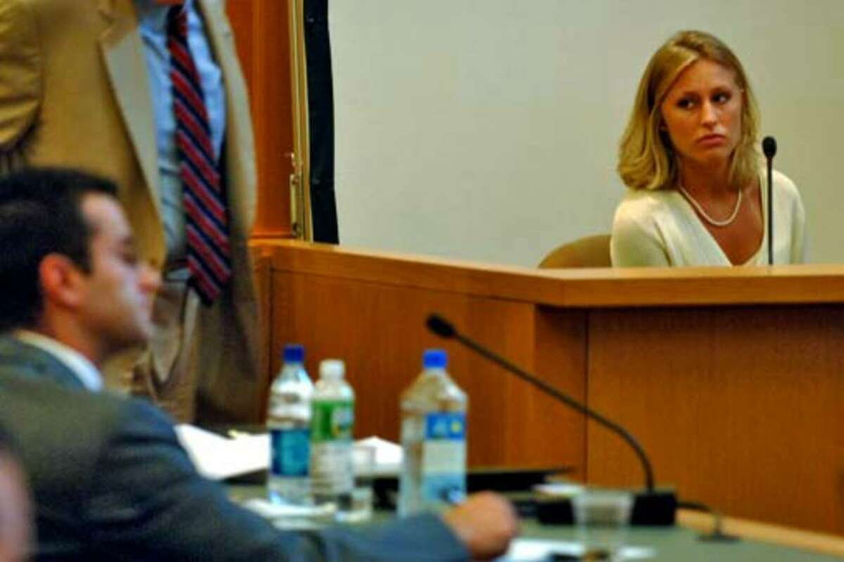 Sarah Fischer testifies about her relationship with Christopher Porco, left, in the Orange County Courthouse in Goshen, Wednesday, July 5. She said they were dating at the about the time of the alleged crime.