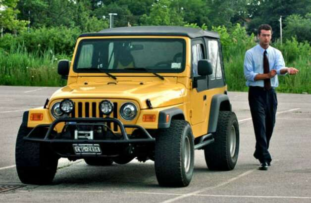 Christopher Porco approaches his Jeep at the end of the day's court session at the Orange County Courthouse in Goshen on Thursday July 6. Photo: Philip Kamrass