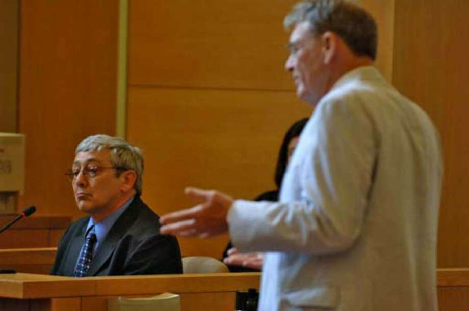 Defense attorney Terence Kindlon, right, cross examines witness John Fallon, a former Thruway toll collector, on Monday, July 10, during the trial of Christopher Porco. Photo: Philip Kamrass