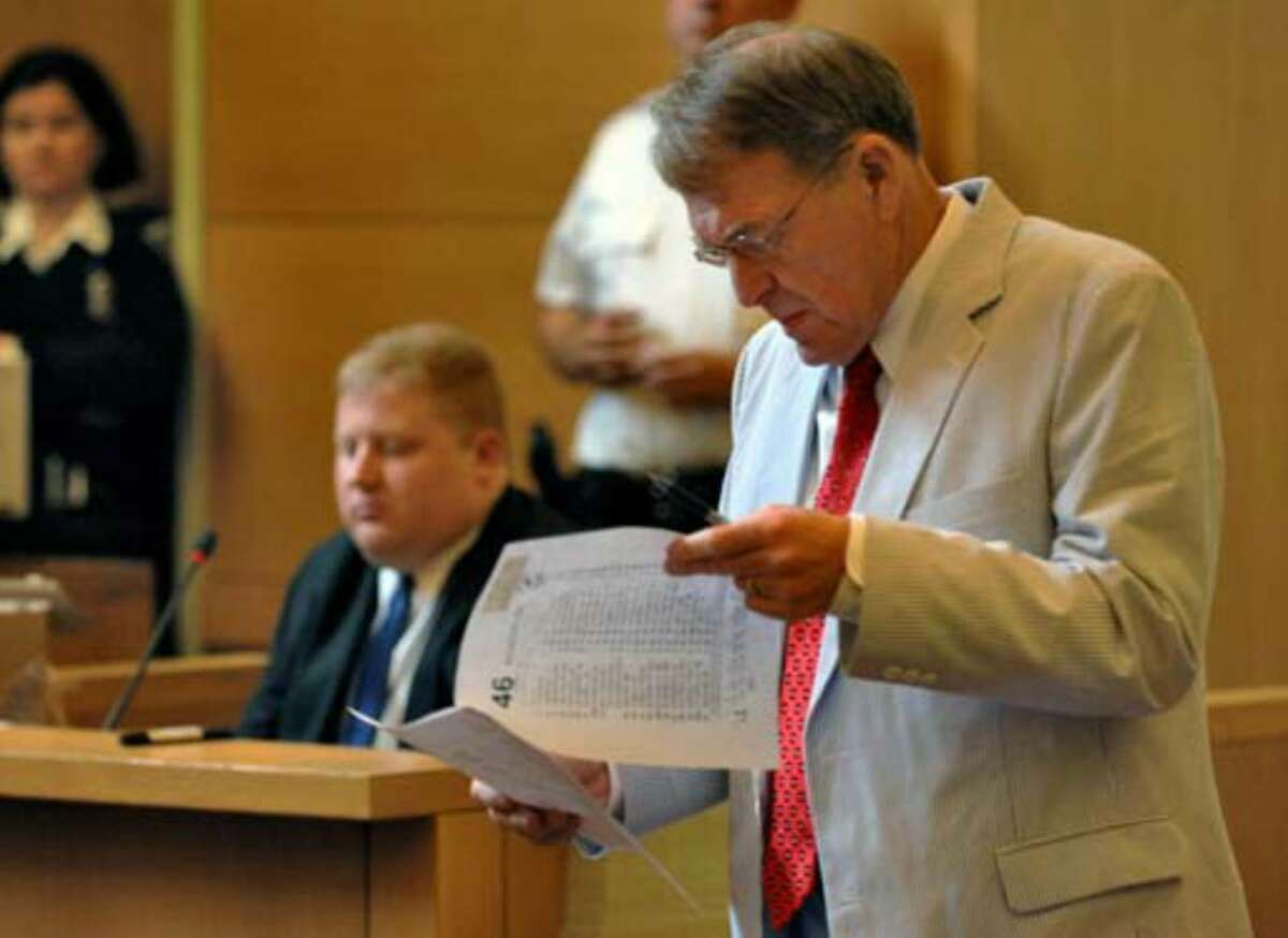 Defense attorney Terence Kindlon examines a photocopy of a toll ticket from the New York State Thruway on Monday, July 10, during the trial of Christopher Porco in Goshen. The prosecution alleges that Porco used the toll ticket when traveling to Albany at the time of the murder. Porco has said he was in his college dormitory in Rochester when the crime took place. Craig Slezak, an accountant with the New York State Thruway Authority, is shown at left.