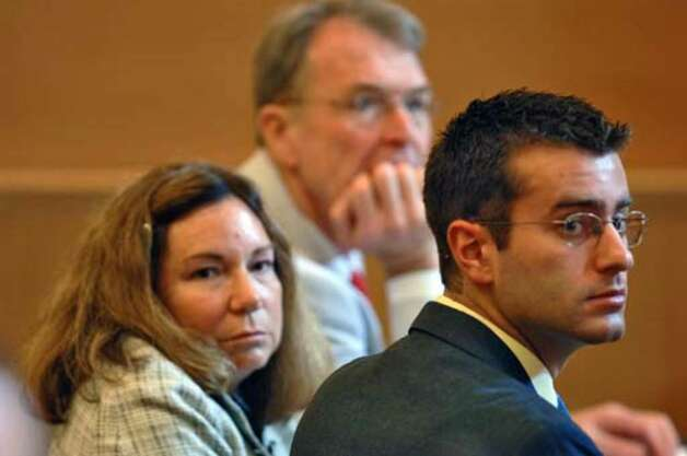 Christopher Porco, at right, and his attorneys Terence Kindlon and Laurie Shanks, are shown at the Orange County Courthouse in Goshen on Monday, July 10. Photo: Philip Kamrass