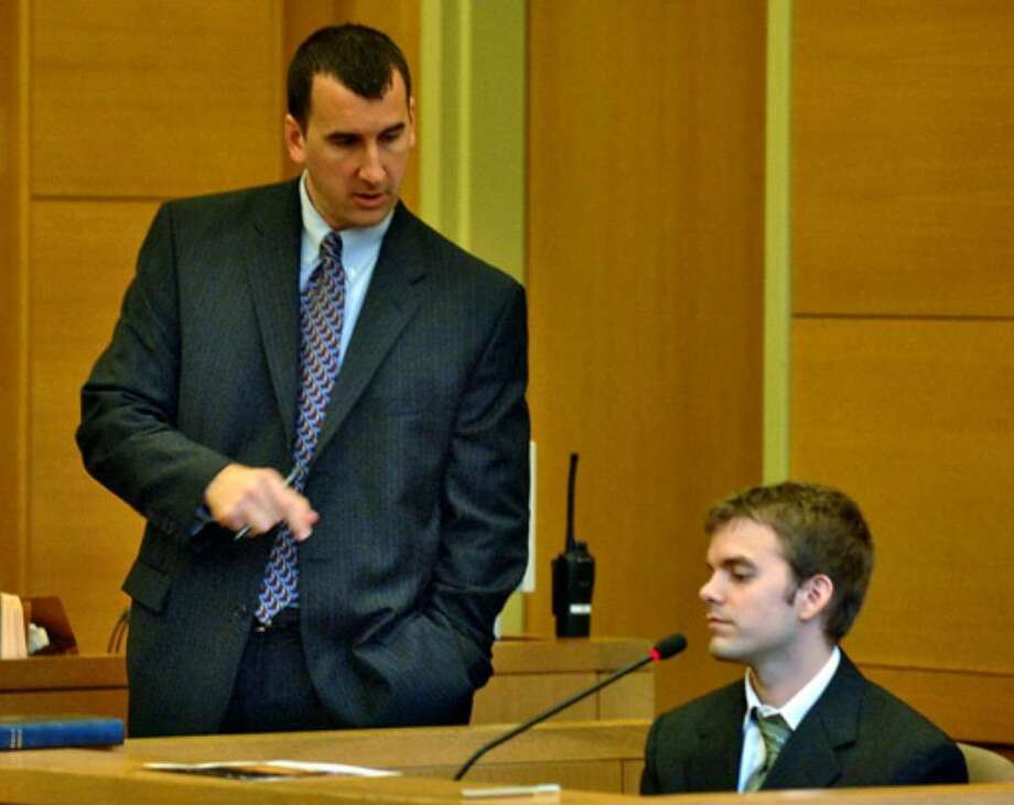 Marshall Crumiller, at right, a former University of Rochester student, answers questions from prosecutor David Rossi. Photo: Philip Kamrass