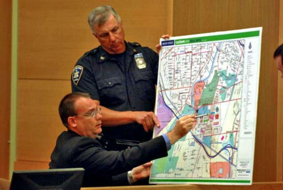 Dana Perrin, a manager in the University of Rochester security department, reviews a map of the university while testifying at the trial of Christopher Porco. Photo: Philip Kamrass