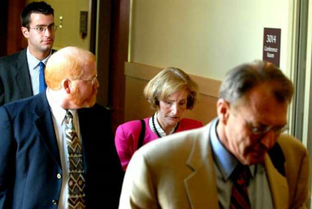 From left, Christopher Porco, John Polster, Attorney and close friend to Joan Porco, Joan Porco, and Defense Attorney Terence Kindlon on July 31, 2006, at the courthouse in Goshen. Photo: Michael P. Farrell