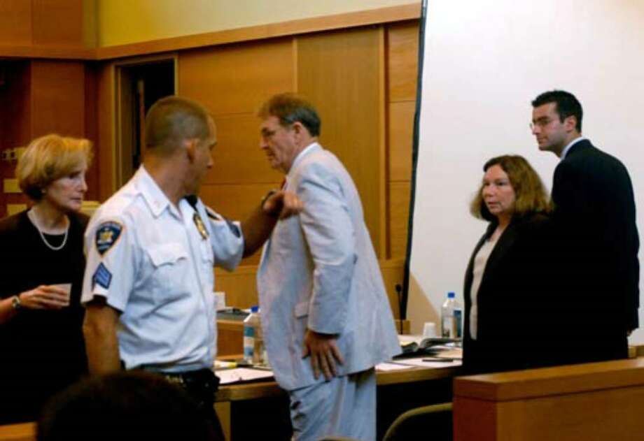 Joan Porco, at left, exits the court following her second day of testimony on August 1, 2006. Also seen, from left, are defense attorneys Terence Kindlon and Laurie Shanks, and Christopher Porco. Photo: Michael P. Farrell