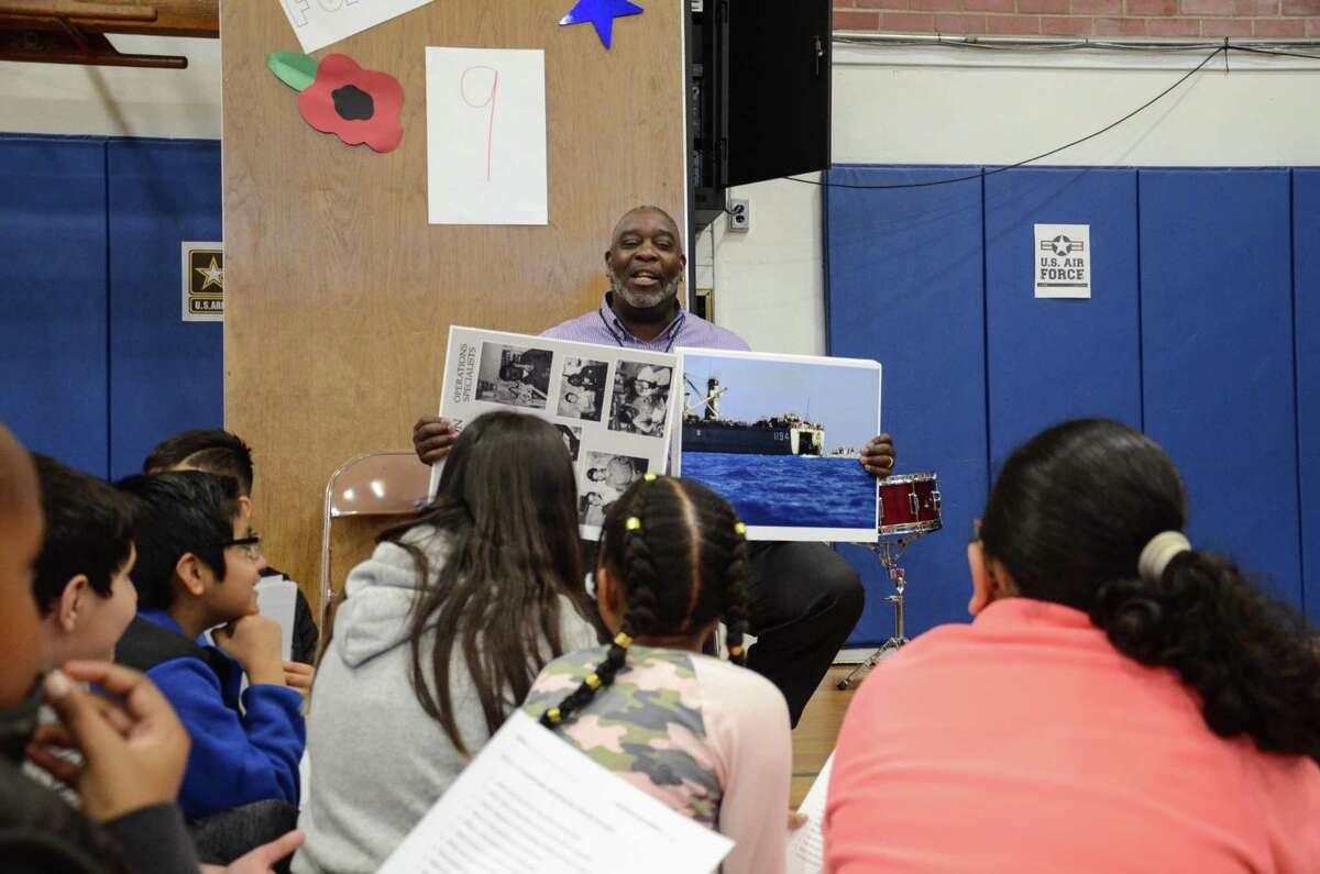Charles Kennerly speaks to a group of fifth graders at Kendall Elementary School on Nov. 12 on Veterans Day. He was an operations specialist in the Navy and told students about his experience while serving.
