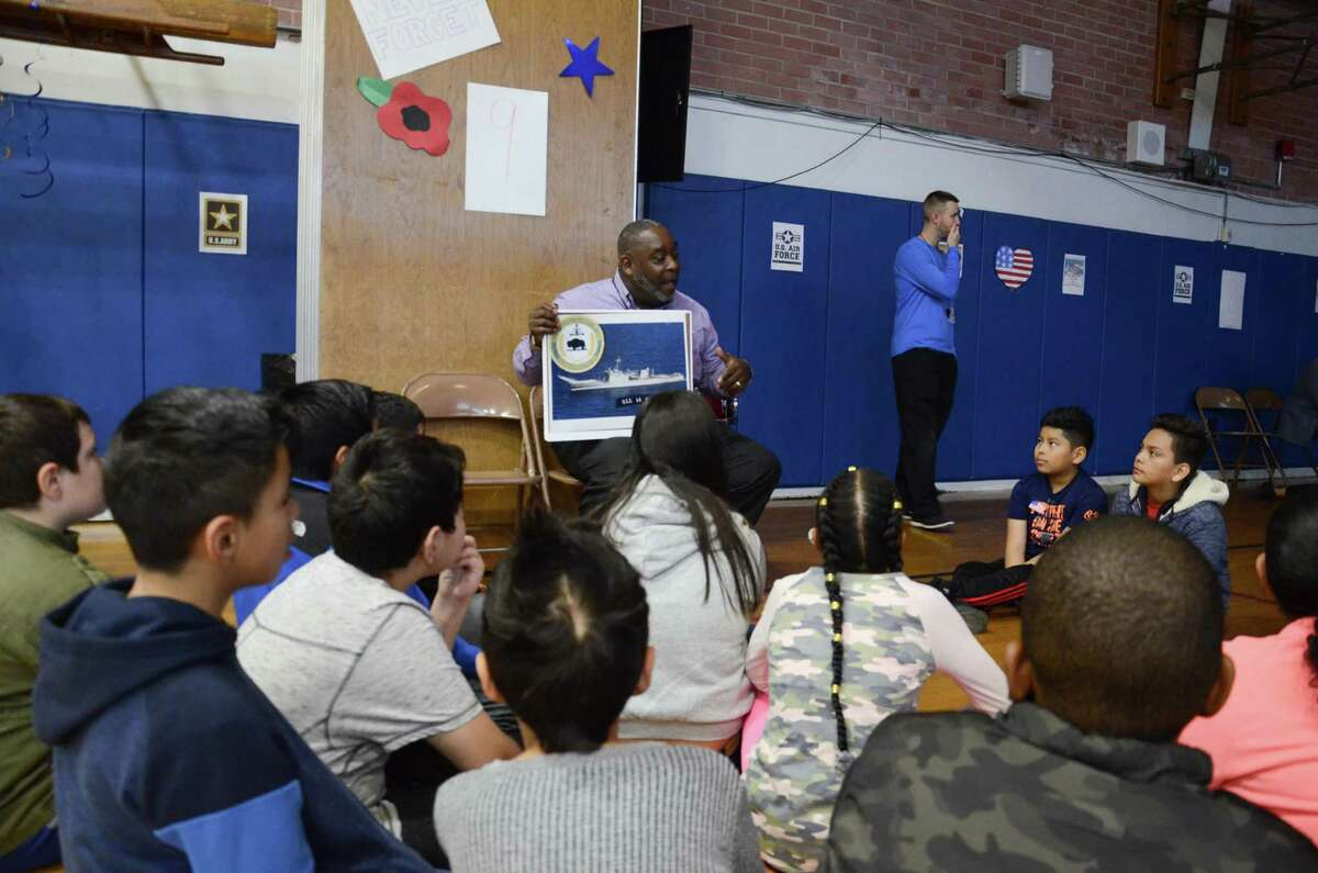 Charles Kennerly, a Navy veteran, spoke to fifth graders at Kendall Elementary School on Nov. 12, Veterans Day. The former operations specialist educated students on the USS La Moure County, the tank landing ship he served aboard.