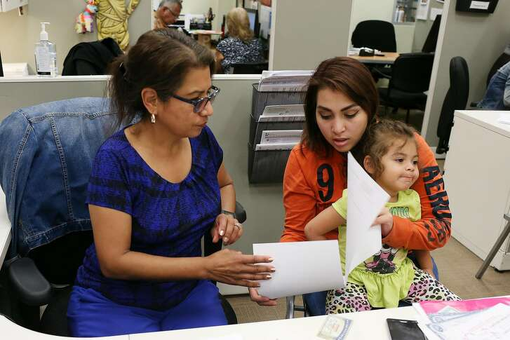 Twenty-two-year-old Sky Gomez holds her daughter, Gisselle Metoyer, 3, as she gets help renewing her Supplemental Nutrition Assistance Program benefits from Annie Gonzales, Client Service Representative at the San Antonio Food Bank, Monday, May 14, 2018. U.S. Representatives Lloyd Doggett, (D-San Antonio), and Joaquin Castro, (D-San Antonio), held a press conference to bring attention huge cuts to the Supplemental Nutrition Assistance Program, (SNAP), in the 2018 Farm Bill that the House is expected to vote on this coming week.