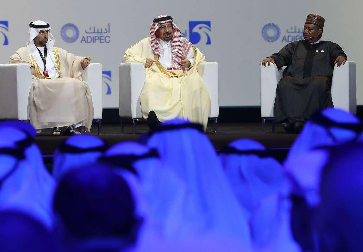 UAE's Energy Minister Suhail Mohammed Faraj al-Mazroui (L), Saudi Energy Minister Khalid al-Falih (C) and OPEC Secretary General Mohammed Barkindo attend the Abu Dhabi International Petroleum Exhibition and Conference (ADIPEC) on November 12, 2018, in the Emirati capital.