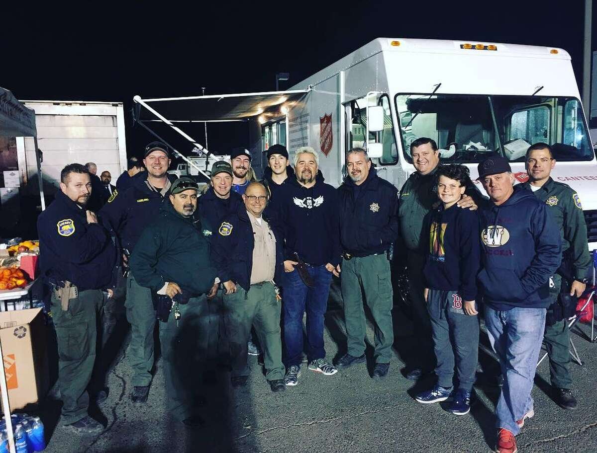 Guy Fieri visited Butte County on Saturday to lend a hand in feeding dozens of first responders taking a break from fighting the Camp Fire.