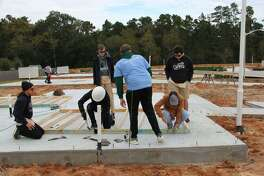 The John Cooper School students kicked off the construction on their 20th consecutive Habitat for Humanity Montgomery County home on Saturday, Nov. 10. They?'re building this house in the Cedar Creek neighborhood in Conroe near Runyan Elementary School.
