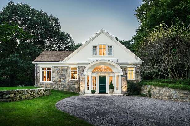 The custom-built contemporary colonial house at 600 Catamount Road sits on a property of more than nine acres abutting the municipally owned Brett Woods Open Space.