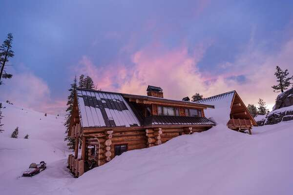 The 5,000-square-foot, five-bedroom Hideout Lodge is located 12 miles south of Kirkwood ski area in a pristine, remote valley off Highway 88. To get there in the winter, you can hop a one-hour private helicopter ride from San Francisco or drive your car to the trailhead and ski or snowshoe two miles in or be shuttled by snowcat the remainder of the way.