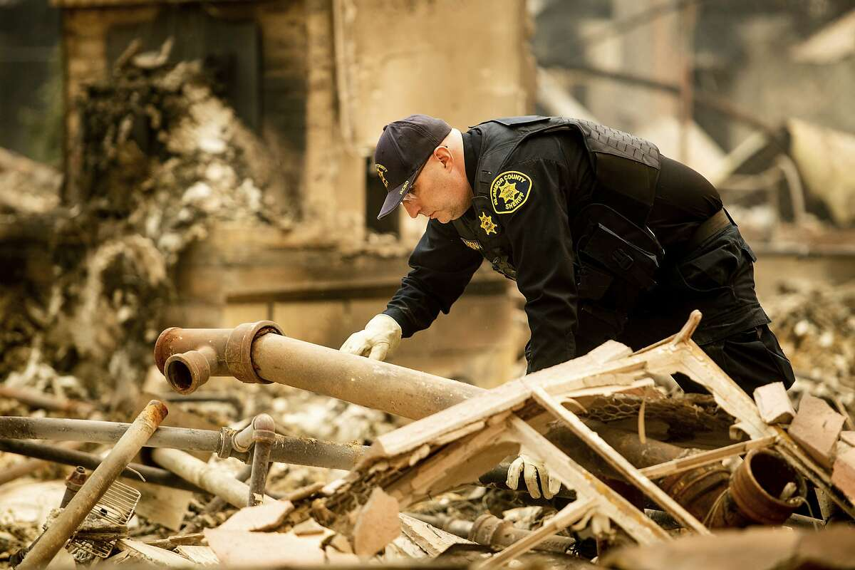 Alameda County Sheriff's deputy A. Gogna searches for victims of the Camp Fire on Monday, Nov. 12, 2018.