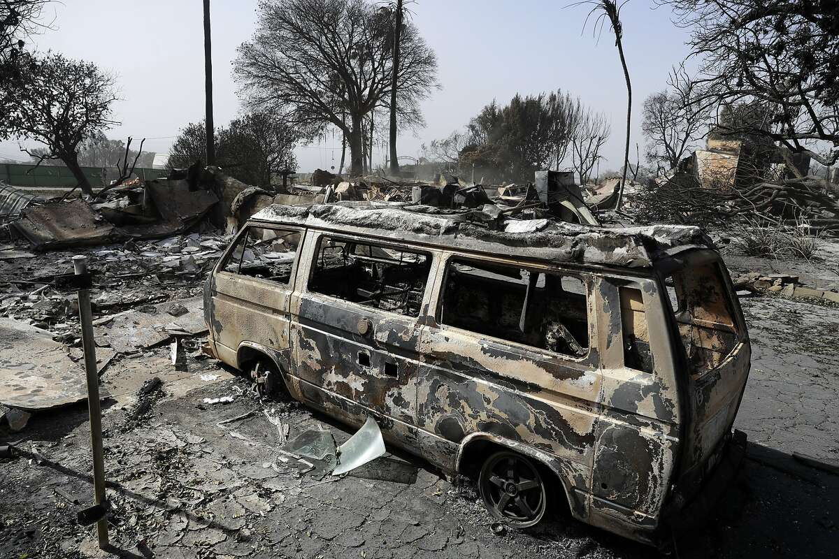 A wildfire-ravaged property is seen Monday, Nov. 12, 2018, in Malibu, Calif. Los Angeles County Fire Chief Daryl Osby says he expects further damage assessments to show that hundreds more homes have been lost on top of the 370 already counted as lost in Southern California's huge wildfires. (AP Photo/Marcio Jose Sanchez)