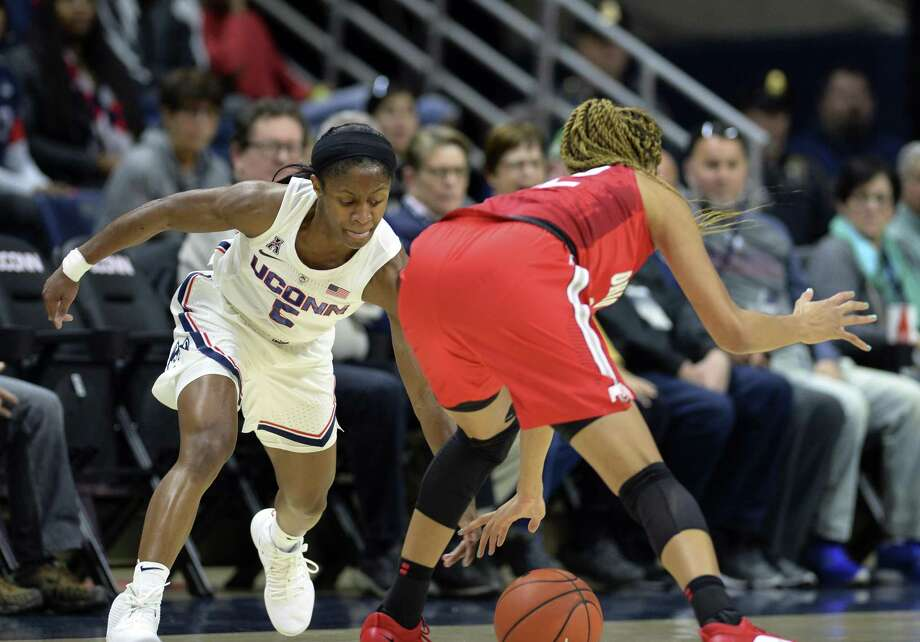 UConn's Crystal Dangerfield (5) attempts a steal against Ohio State's Adreana Miller (15) during Sunday's game in Storrs. Photo: Stephen Dunn / Associated Press / Copyright 2018 The Associated Press. All rights reserved