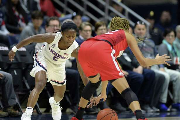 UConn's Crystal Dangerfield (5) attempts a steal against Ohio State's Adreana Miller (15) during Sunday's game in Storrs.