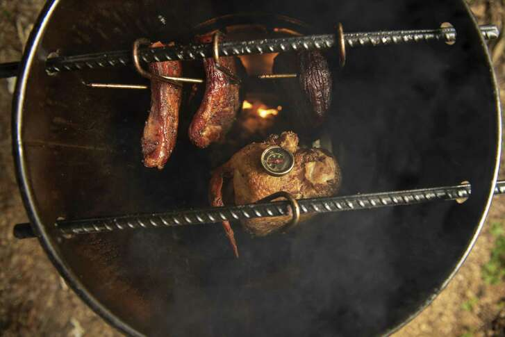 Meat placed inside the Pit Barrel Cooker hangs on hooks placed on rebar inside the device. That allows the air to circulate around the meats at even temperatures.