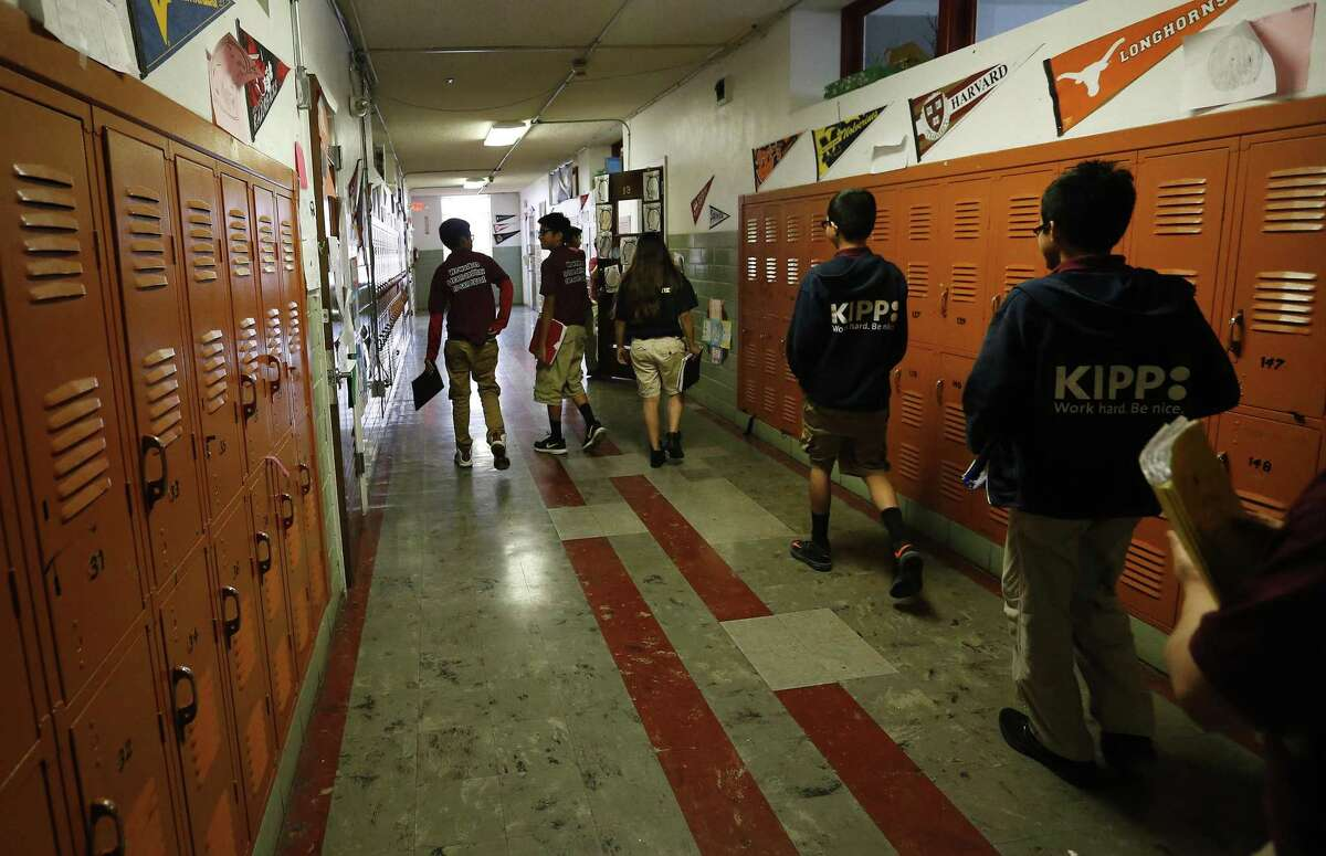 Growing enrollment in local charter schools prove parents are hungry for alternatives. Here, KIPP Aspire seventh-graders change classes.