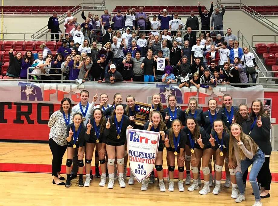 The Midland Classical Academy volleyball team won its first state championship Friday by defeating New Braunfels Christian Academy in five sets. Team members and coaches are coach Amie Miller, back row from left, coach Jared Nelson, Kacy Miller,  Paytan Parham, Lizabelle Russell, Marin Casey, Emma Westfall, Elise Grigsby, Madison Hunter, Cammie Stokes, Abby Pendergrass and coach Lindsy Dunn, and Madelynn Marecle, front row from left, Grace Coco, Leia Beattie, Kenna Bayley, Jacqueline Copley,  Jenny Coco, Kyler Kirk and manager Addison Todd. Photo: Courtesy Photo