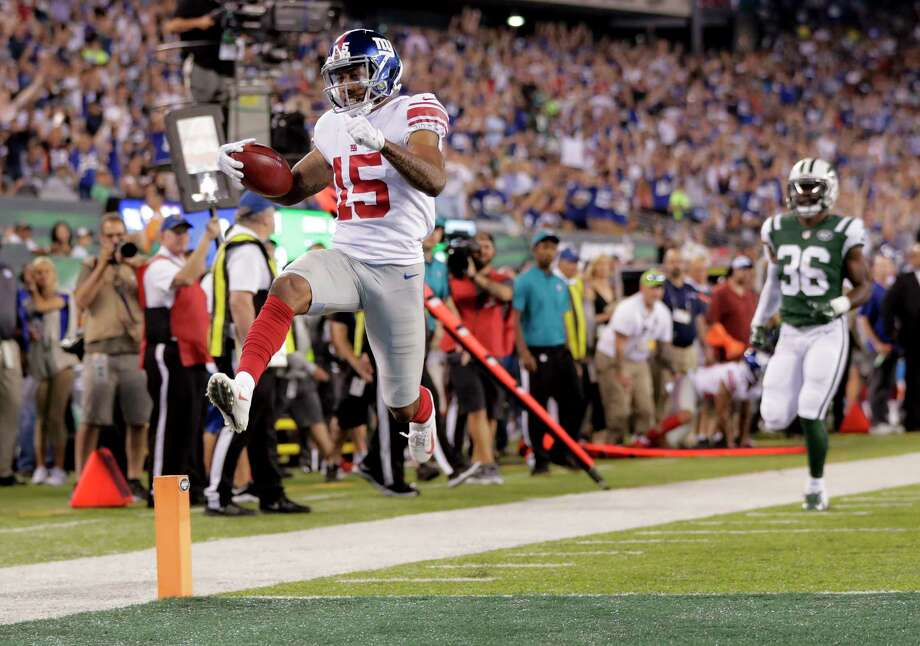 New York Giants wide receiver Hunter Sharp (15) scores a touchdown against the New York Jets during the first quarter of an NFL football game, Friday, Aug. 24, 2018, in East Rutherford, N.J. (AP Photo/Julio Cortez) Photo: Julio Cortez, Associated Press / Copyright 2018 The Associated Press. All rights reserved.