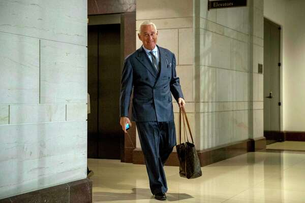 FILE - In this Sept. 26, 2017, file photo, longtime Donald Trump associate Roger Stone arrives to testify before the House Intelligence Committee, on Capitol Hill in Washington. An associate of Stone said Monday, Nov. 12, 2018, that he expects to face charges in the special counsel's Russia investigation. Conservative conspiracy theorist Jerome Corsi said on his YouTube show that negotiations fell apart with special counsel Robert Mueller's team and he expects in the coming days to be charged with making false statements.