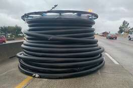 Two large spools are blocking several main lanes of the East Freeway westbound at Wayside Drive.