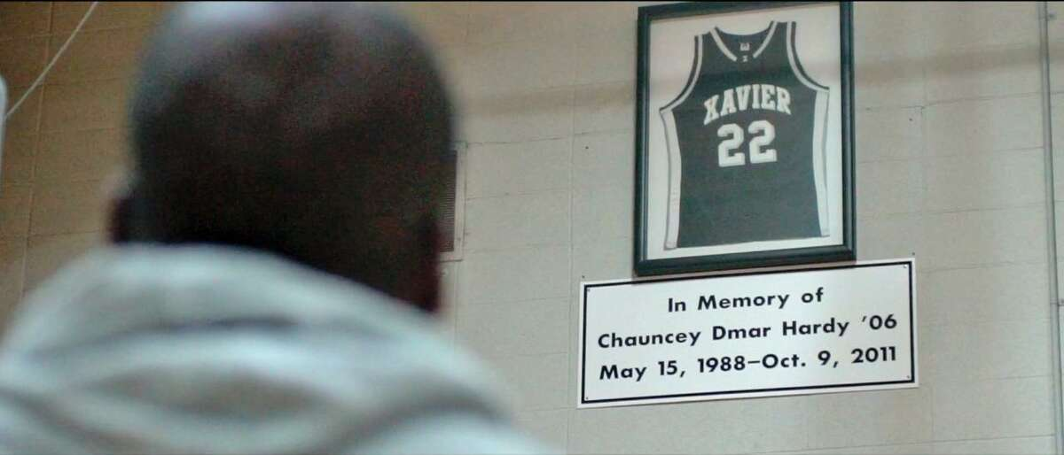 """Spievey is shown in a scene from """"INSPIRED: The Amari Spievey Story."""" His cousin Chauncey Hardy was killed in Romania in 2011."""