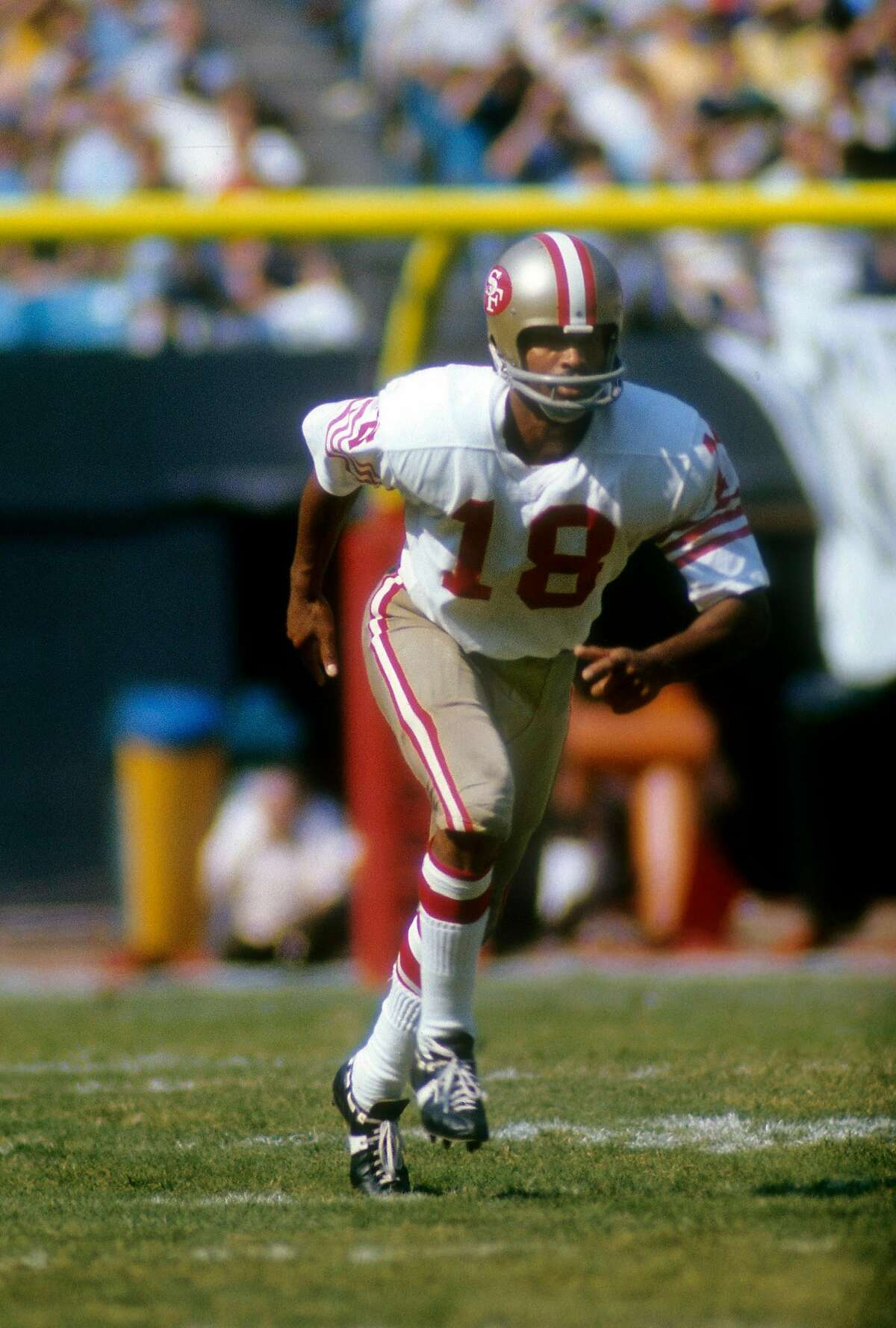 CIRCA 1970: Wide Receiver Gene Washington #18 of the San Francisco 49ers runs a pass rout during an NFL football game circa 1970. Washington played for the 49ers from 1969-76. ~~