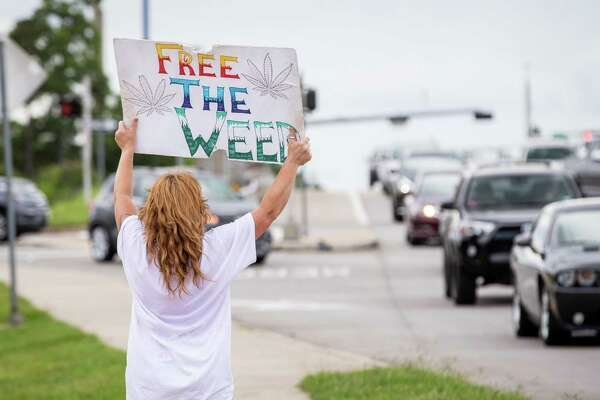 Dobbin resident Donna Deslauriers participates during the Cannabis Open Carry Walk on Saturday, Aug. 4, 2018, off of North Loop 336 in Conroe.
