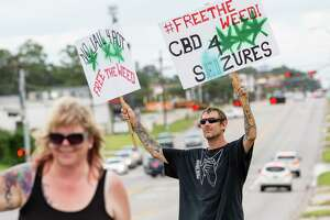 Montgomery resident JT Thomas participates in the Cannabis Open Carry Walk on Saturday, Aug. 4, 2018, off of North Loop 336 in Conroe.