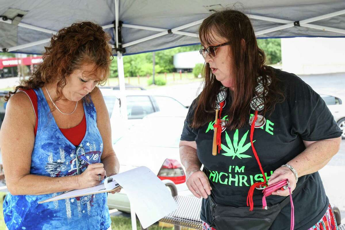 Montgomery resident Cindy Nona gathers contact information from participants of the Cannabis Open Carry Walk in August 2018. On Tuesday, law enforcement officials representing the Texas Police Chiefs Association and the Sheriffs' Association of Texas said legalization of the drug would bring increased crime, entice a dangerous black market and lead to increased use of other, more addictive drugs.