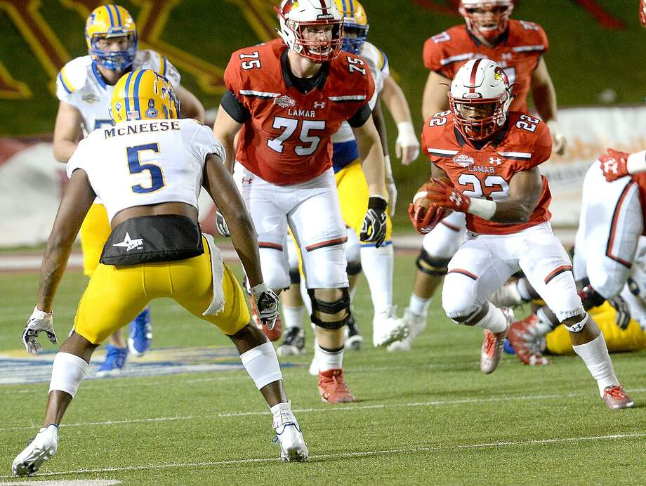 Lamar's Myles Wanza looks to evade McNeese State's defense as he runs the ball during the Cardinals' final home game at Provost Umphrey Stadium Saturday. Photo taken Saturday, November 18, 2017 Kim Brent/The Enterprise Photo: Kim Brent / Beaumont Enterprise / BEN