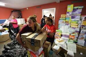 Volunteers attempt to fulfill the needs of the area community hit hard by Hurricane Harvey in the Oak Meadows Community Worship Center 6105 Allendale Rd. Thursday, Sept. 14, 2017, in Houston.
