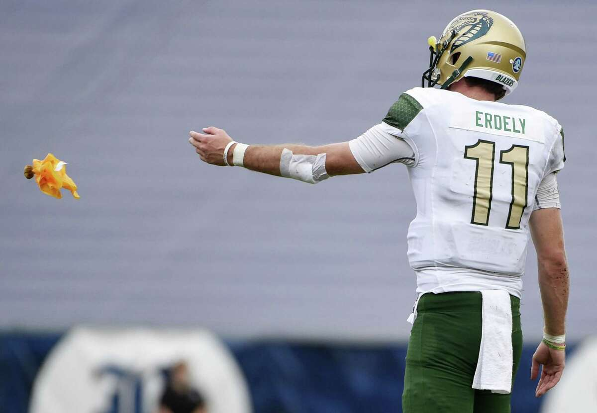 UAB quarterback A.J. Erdely throws a penalty flag back to an official during the second half of an NCAA college football game against Rice, Saturday, Oct. 13, 2018, in Houston.