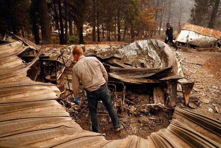 Chico Police Chaplin Dan Wysong searches for victims of the Camp Fire in the Pine Springs Mobile Home Park in Paradise, Calif. on Monday, November 12, 2018. Wysong's home was destroyed in the fire.