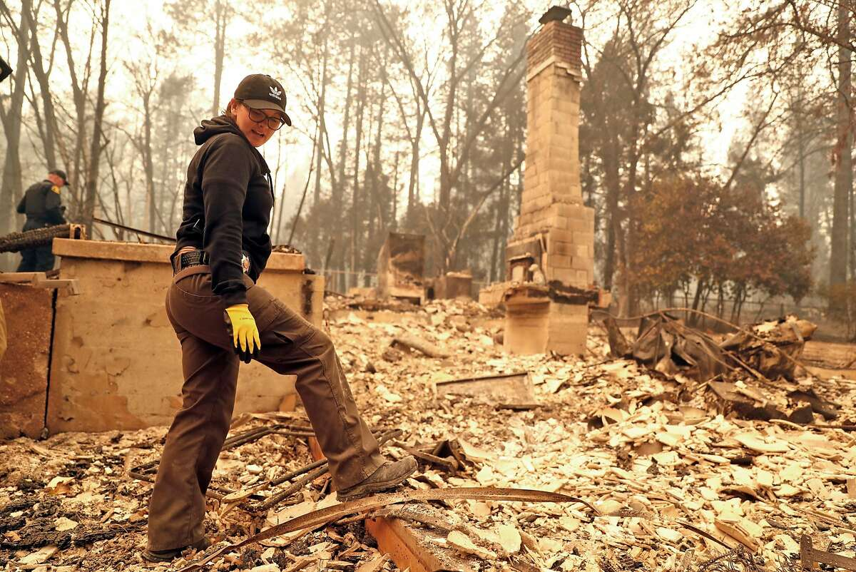 Butte County Investigator Tiffany Larson searches for victims of the Camp Fire in Paradise, Calif. on Monday, November 12, 2018. Larson lost her home in the wildfire.