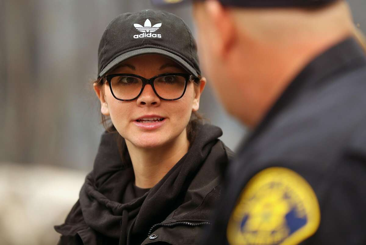 Butte County Investigator Tiffany Larson talks with Alameda County Sheriff's Dept. Sgt. Howard Baron in aftermath of Camp Fire in Paradise, Calif. on Monday, November 12, 2018.