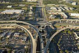The view north along U.S. 281 past the Loop 1604 flyovers in a 2017 file photo. About a mile of northbound traffic will be squeezed into the new frontage road starting Tuesday, reducing speed to 45 mph.