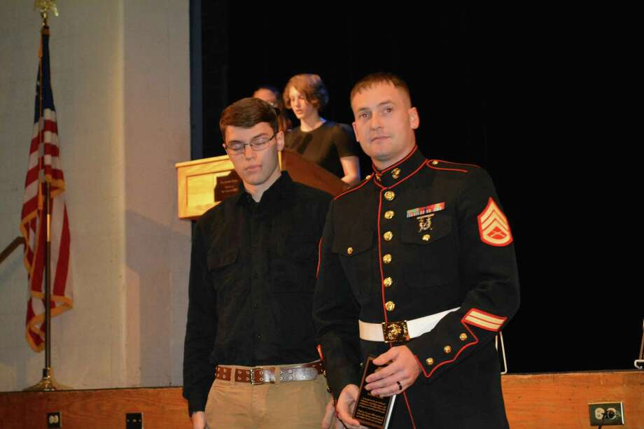 Marine Staff Sergeant Henkel received a plaque for his volunteer work at the Gilbert School. Photo: Leslie Hutchison / Hearst Connecticut Media