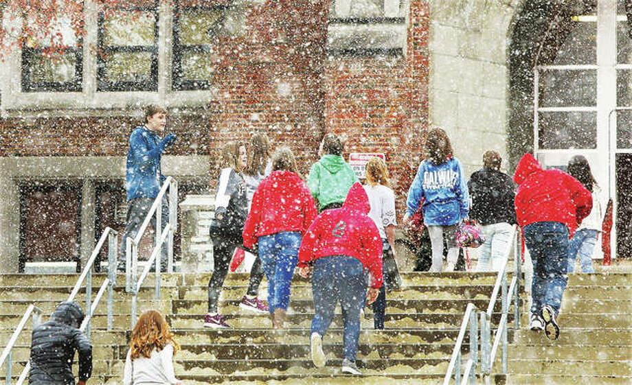 Alton Middle School students seem to enjoy a class change Monday afternoon, where they got to run between the buildings in the blowing snow. The area was under a winter weather advisory from the National Weather Service Monday afternoon, with at least some slight accumulation expected. The possibility of more snow is in the forecast for Thursday. Photo: John Badman | The Telegraph