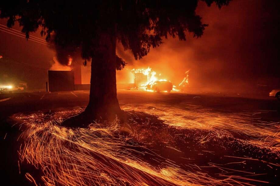 Flames consume a Kentucky Fried Chicken as the Camp Fire tears through Paradise, Calif., on Thursday, Nov. 8, 2018. (AP Photo/Noah Berger, File) Photo: Noah Berger / Noah Berger