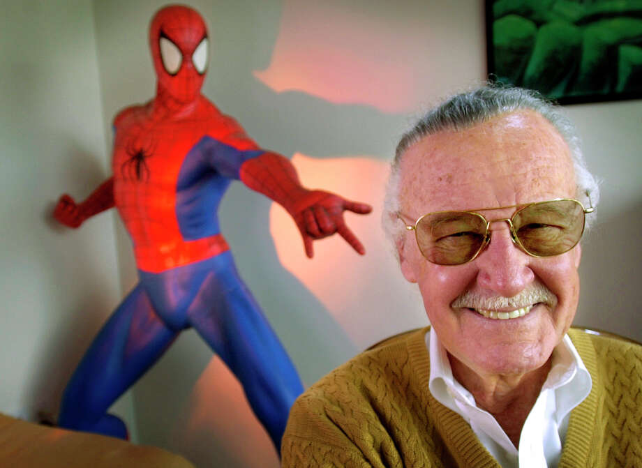 "FILE - In this April 16, 2002, file photo, Stan Lee, 79, creator of comic-book franchises such as ""Spider-Man,"" ""The Incredible Hulk"" and ""X-Men,"" smiles during a photo session in his office in Santa Monica, Calif. Comic book genius Lee, the architect of the contemporary comic book, has died. He was 95.   (AP Photo/Reed Saxon, File) Photo: REED SAXON / AP2002"