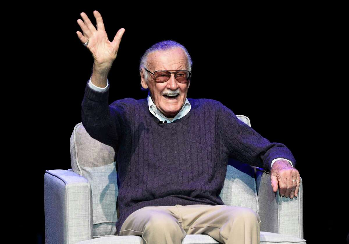 FILE - In this Aug. 22, 2017, file photo, comic book writer Stan Lee waves to the audience after being introduced onstage at the